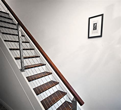 modern banister installing a modern railing on a closed box staircase