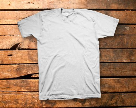 T Shirt Kaos Wood t shirt on wood background mock up digital psd file from