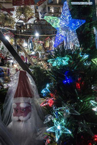 people buy christmas decorations at roadside market in