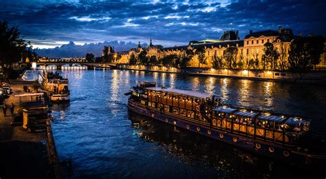 boats on the seine the 10 best restaurants in paris with a view of the seine