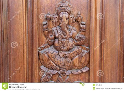major themes in god s bits of wood ganesha on teakwood door stock image image of engraving