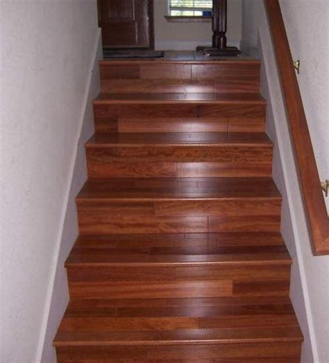 consider laminate for your staircase it looks great is much cheaper than hardwood renew