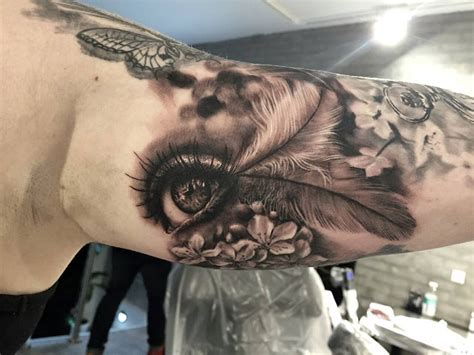 feather tattoo near eye realistic eye flowers feathers bicep best tattoo
