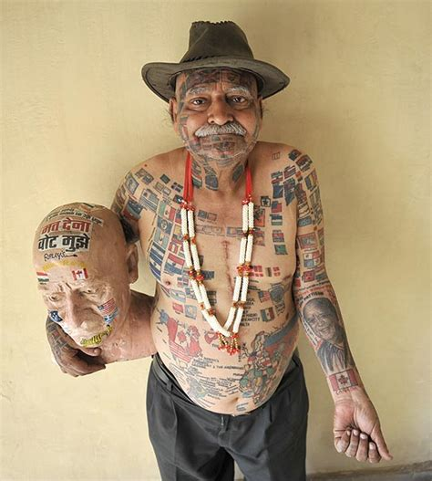 70 year old man has 305 country flag tattoos