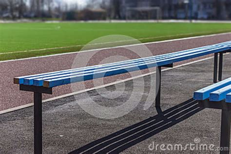 soccer bench seats wooden bench seats for fans on soccer football field stock
