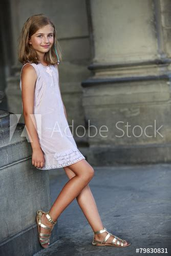 Beautiful Young Girl In Summer Dress In Venice Italy