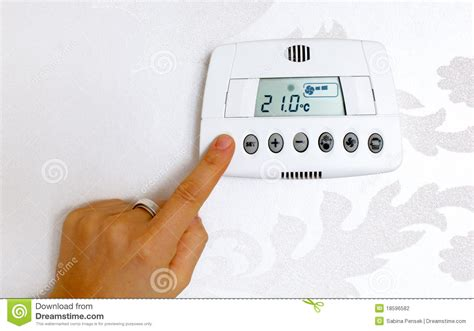Set The Heat Thermostat Temperature Setting In A Modern Home Stock