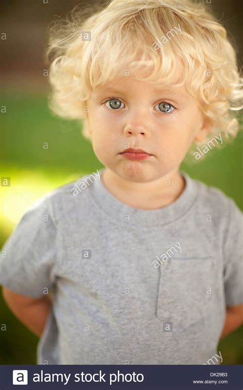toddler boy with blonde hair styles close up portrait of innocent blonde toddler boy with