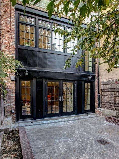 black houses  pros  cons   dark painted facade