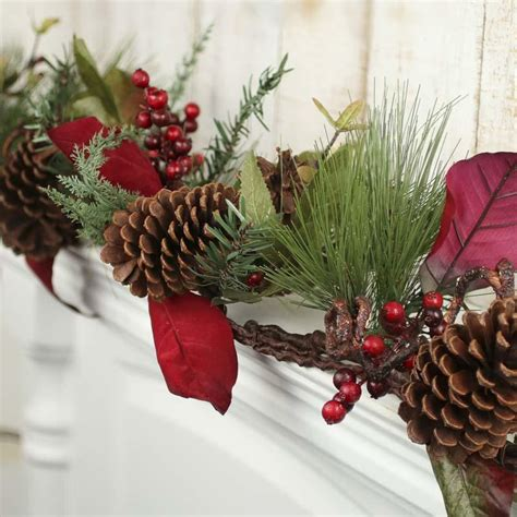 large artificial pine and berry garland christmas