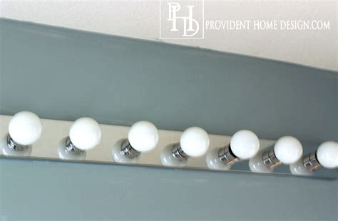 changing a bathroom light fixture how to replace a light with 2 vanity lights