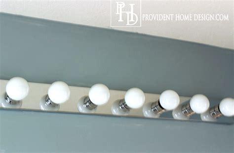 replacing bathroom vanity light fixture how to replace a bathroom light fixture how tos how to replace a hollywood light with 2 vanity lights