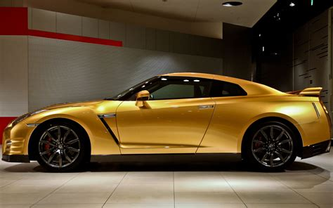 nissan gold sold golden usain bolt nissan gt r gets 187 100 winning