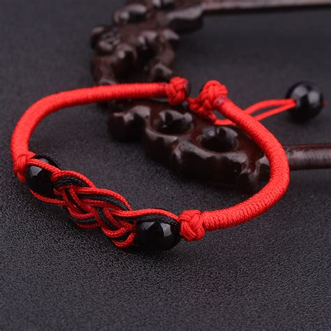 Ornamental Knotting And Weaving Of Thread - a handmade jewelry knots traditional weave thread