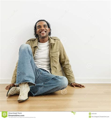 Sitting On by Sitting On Floor Stock Photo Image Of Color Person 4416700