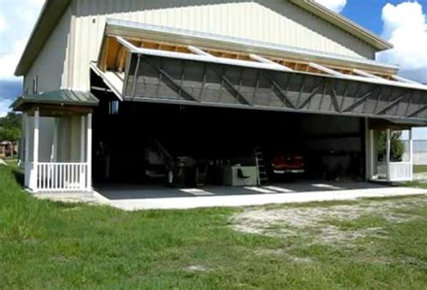 3 car garage door hangar house wall with porch turning into lifted garage door