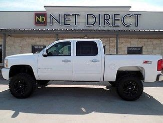 "find used 09 chevy lift 4x4 new 18"" wheels 35"" tires 5.3"