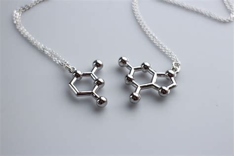 I Like How They Paired The Pendants With A Different But   dna base pair molecule necklace friendship necklace pair