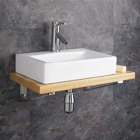bathroom basins with storage wall mounted wooden shelf white ceramic rectangular sink