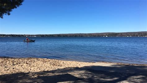 green lake boat launch michigan search efforts turn from rescue to recovery for missing