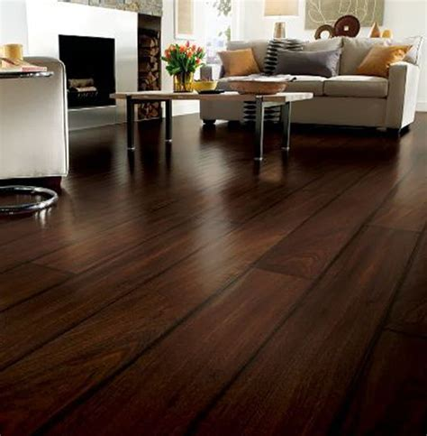 laminated walnut wooden floor and brown sofas with interior design the awesome flooring of your home