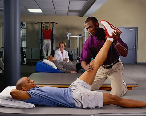 therapy exercises physical therapist working with patient