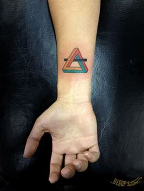 triangle tattoo on arm meaning 67 best triangle tattoos ideas
