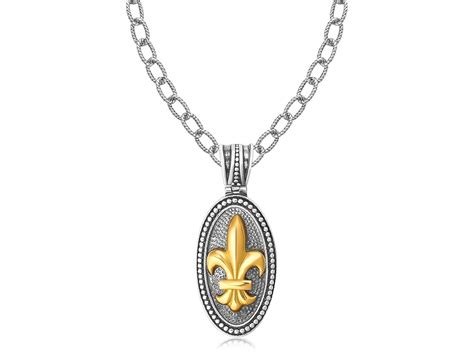 oval fleur de lis style pendant in 18k yellow gold and