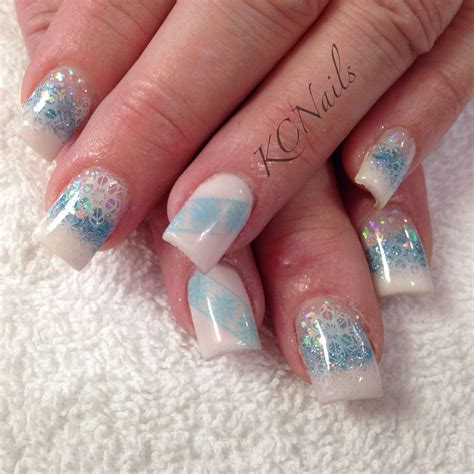snowflake pattern on nails winter wonderland white and blue acrylic nail fade