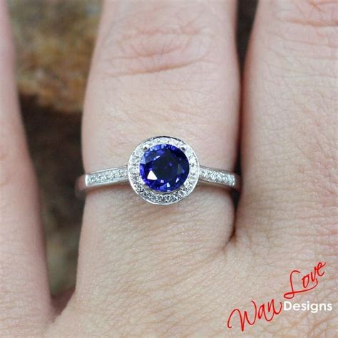 blue sapphire halo engagement ring channel prong
