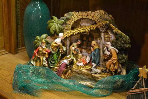 christmas manger sets unto us a child is born nativity sets tell the news