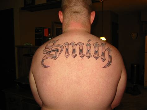 last name tattoos for men last name across my back picture
