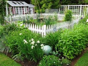White picket fence as a border of a vegetable garden