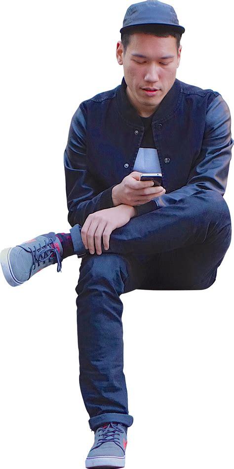 man sitting using phone architextures
