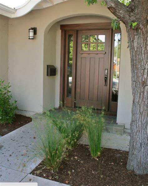 amazing Front Door Colors For Beige House #1: stained-front-door.jpg