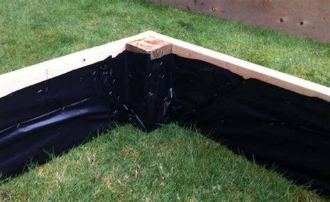flower bed liner staple plastic sheeting to the inside of raised beds to