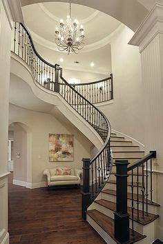 curved staircase foyer entryway home decor  interior