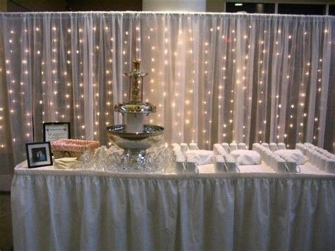 gossamer wedding decor using christmas lights in