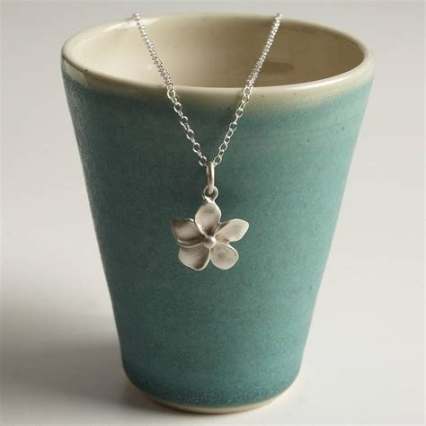 silver flower necklace by charmed
