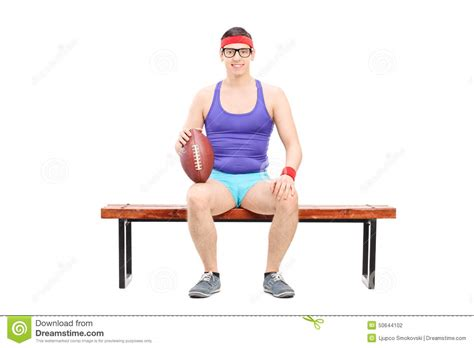 football player on bench male football player sitting on a bench stock photo image 50644102