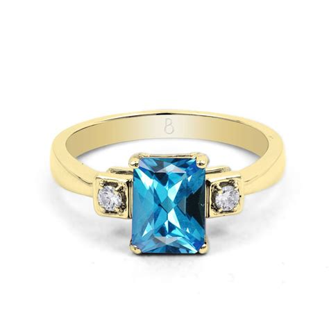 18ct yellow gold blue topaz engagement ring 0