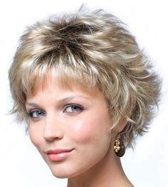 choppy bob hairstyles 1980 short hair big bangs winged sides 80s hair makeup