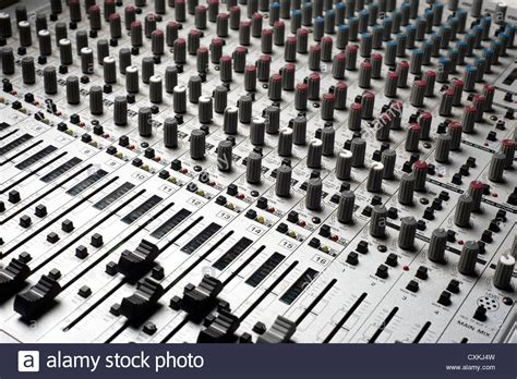 Soundboard Knobs by Audio Recording Equipment Or Soundboard Background With