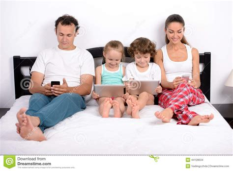family in bed stock photo image of read hold child