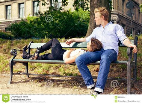 couple on park bench romantic couple resting on the park bench stock images