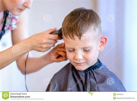 can hair dye be used on lillte boy hair handsome little boy getting a hair cut stock photo image