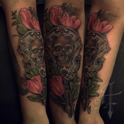 tattoo lettering mirrored arm skull mirror tattoo by antony tattoo