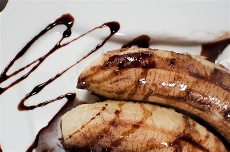 Banana Chocolate Melted closeup of two bananas melted with chocolate stock images