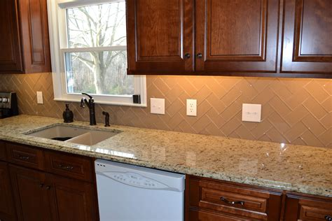 chage glass subway tile herringbone kitchen backsplash