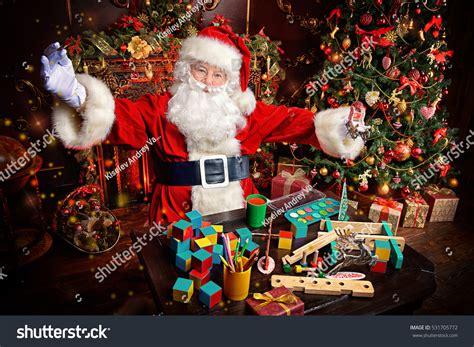 img of santa claus and x mas tree workshop santa claus portrait santa claus stock photo 531705772